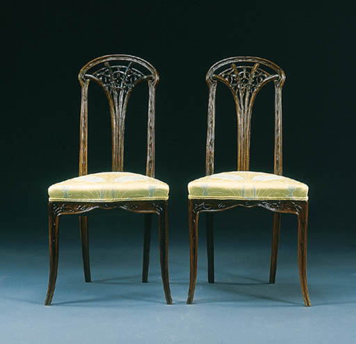 A PAIR OF CARVED MAHOGANY 'CLE