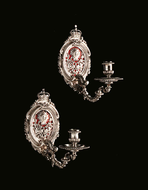 A HIGHLY IMPORTANT PAIR OF WILLIAM AND MARY SILVER ROYAL WALL SCONCES