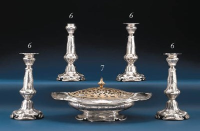 A SET OF FOUR SILVER CANDLESTI