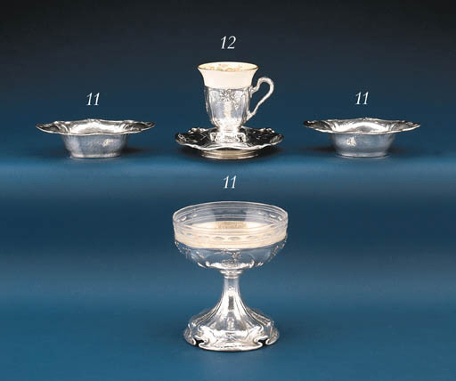 A SET OF FIFTEEN SILVER DESSER
