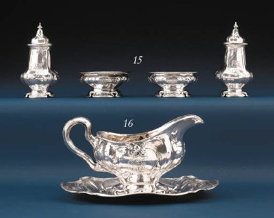 A SET OF EIGHT SILVER PEPPER C