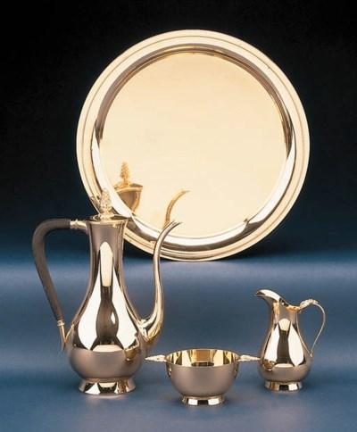 A GOLD THREE-PIECE COFFEE SERV