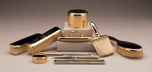 A GOLD TEN-PIECE DRESSING TABL