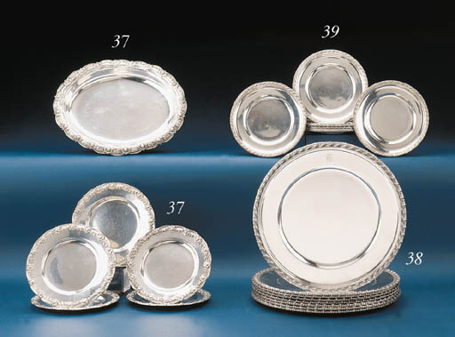 A SET OF EIGHT SILVER BREAD-AN