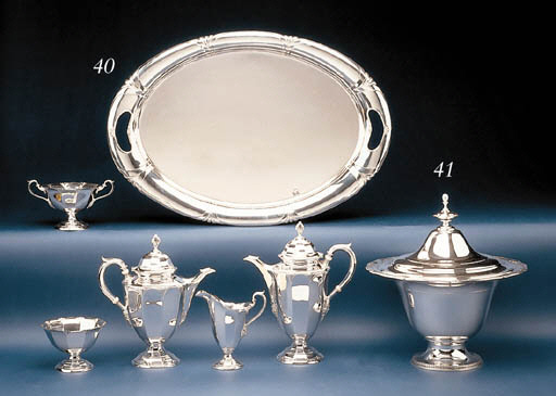 A SILVER URN AND COVER