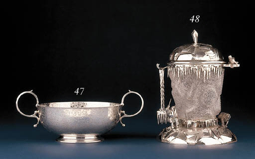 A SILVER AND GLASS ICE BUCKET