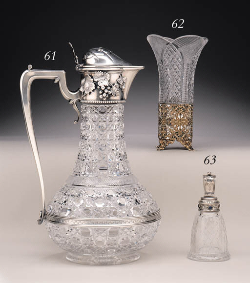 A GEM-SET SILVER-MOUNTED GLASS