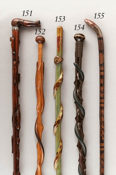 A CARVED AND STAINED WALKING S