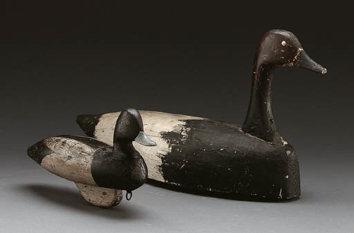 A CARVED AND PAINTED GOOSE DEC