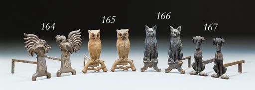 A PAIR OF CAST-IRON OWL ANDIRO