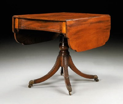A CLASSICAL CARVED MAHOGANY PE
