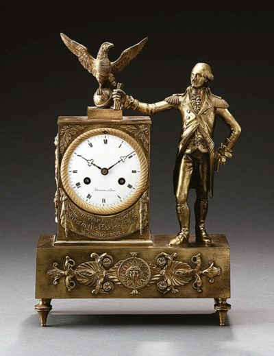A GILT-BRONZE MANTEL CLOCK WIT