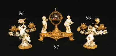 A LOUIS XV/XVI ORMOLU AND MEIS