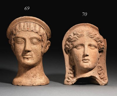 AN ETRUSCAN TERRACOTTA VOTIVE