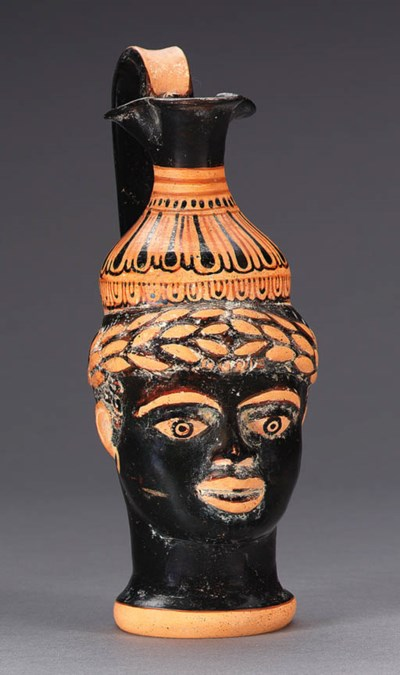 AN ETRUSCAN HEAD VASE