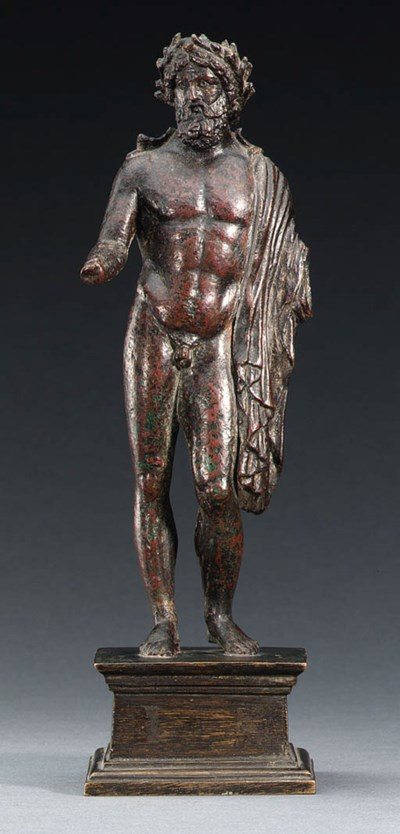 A ROMAN BRONZE FIGURE OF ZEUS