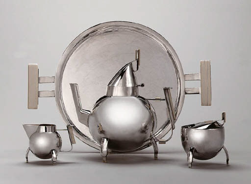 A SILVER AND IVORY TEA SERVICE