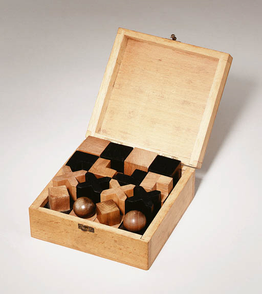 A WOODEN CHESS SET IN COVERED