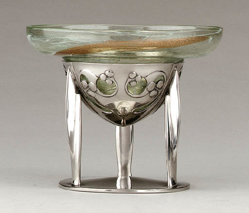 A PEWTER AND GLASS COMPOTE