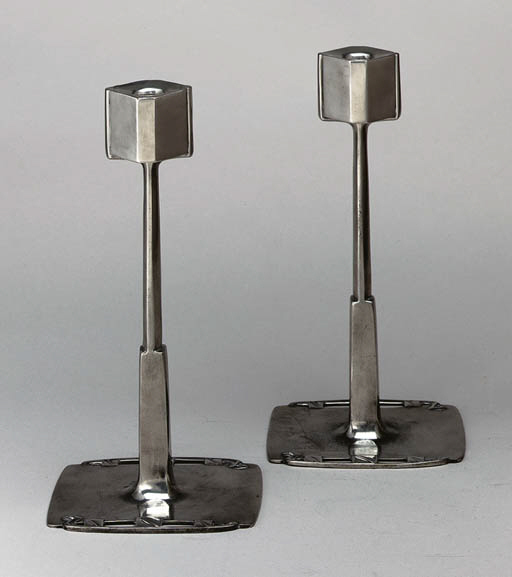 A PAIR OF PEWTER CANDLESTICKS
