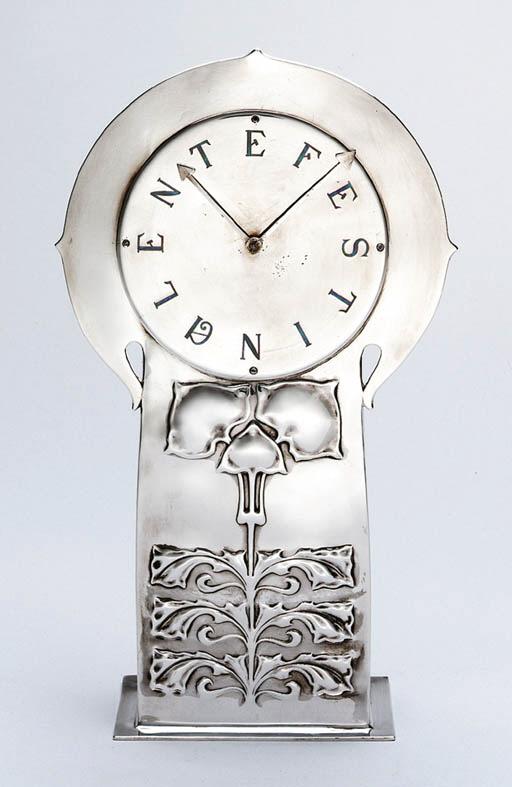 AN ENAMELED SILVER CLOCK