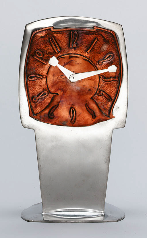 A PEWTER AND COPPER CLOCK