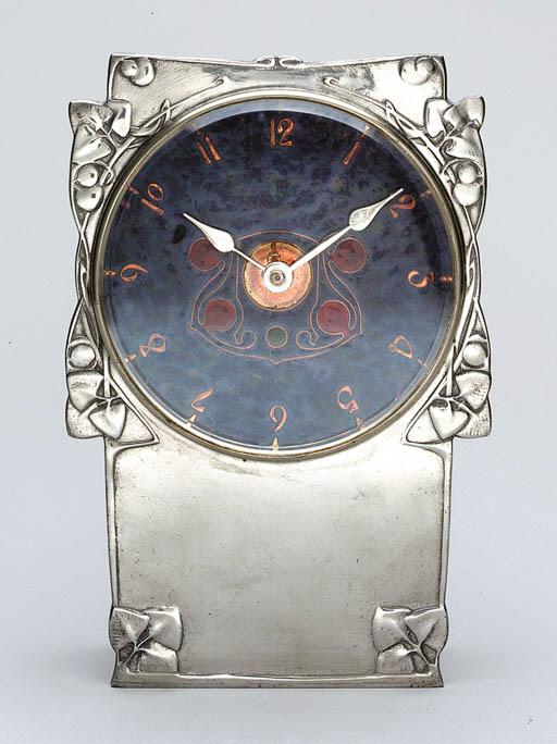 AN ENAMELED PEWTER CLOCK