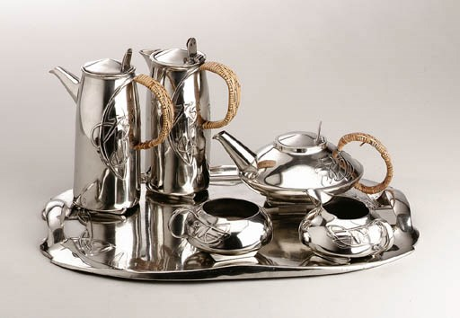 A FIVE-PIECE PEWTER AND RATTAN