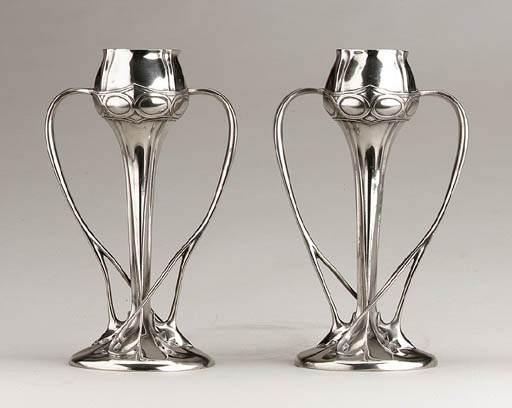 A PAIR OF PEWTER TWO-HANDLED V