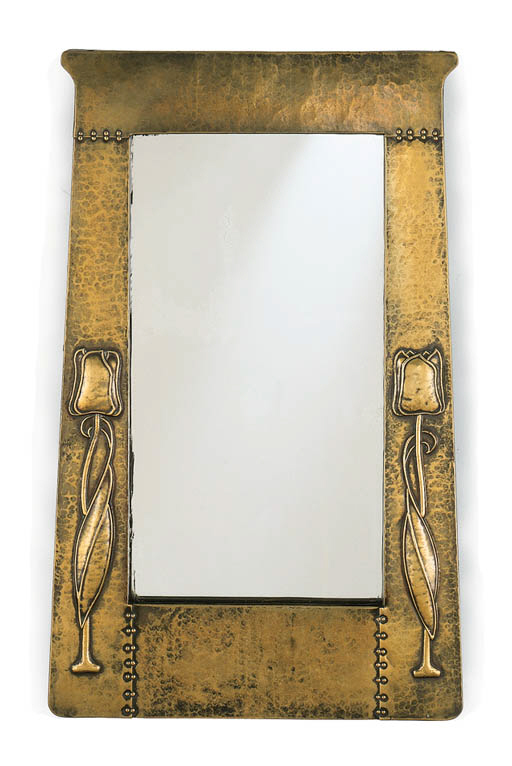 A REPOUSSE BRASS MIRROR WITH T