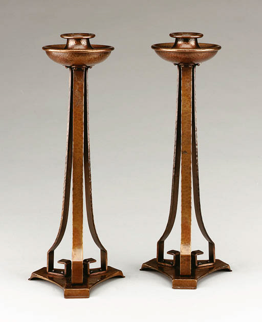A PAIR OF COPPER CANDLESTICKS