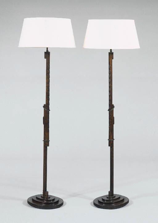 A PAIR OF OAK FLOOR LAMPS