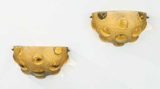 'SOLEIL', A PAIR OF AMBER MOLD