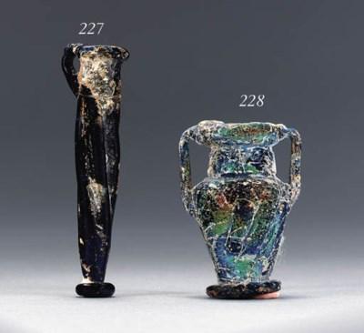 A BYZANTINE GLASS UNGUENTARIUM