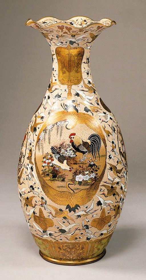 A Massive Earthenware Vase Wit