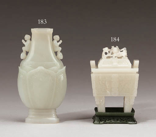 A Small White Jade Archaistic