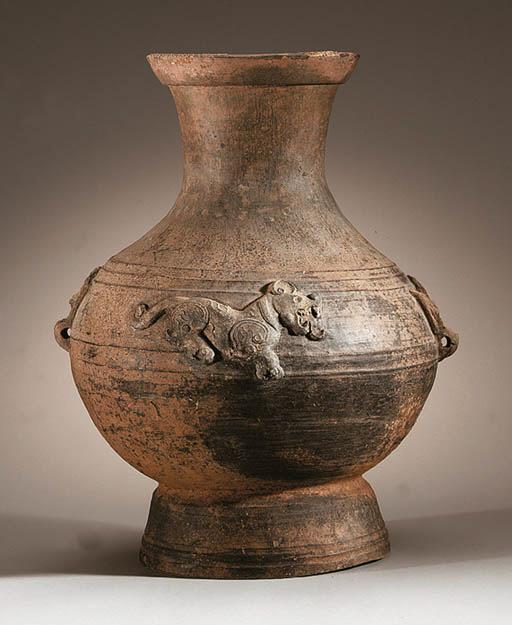 An Unusual Grey Pottery Jar, H