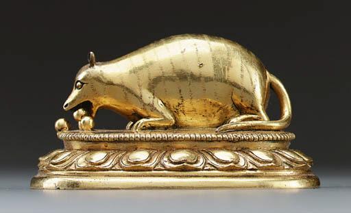 A Gilt Bronze Figure of a Mong