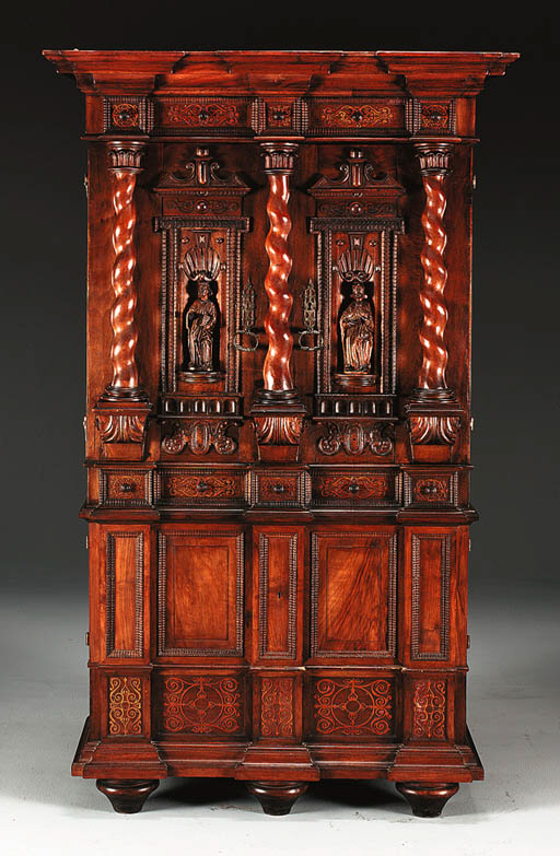 A GERMAN WALNUT CABINET