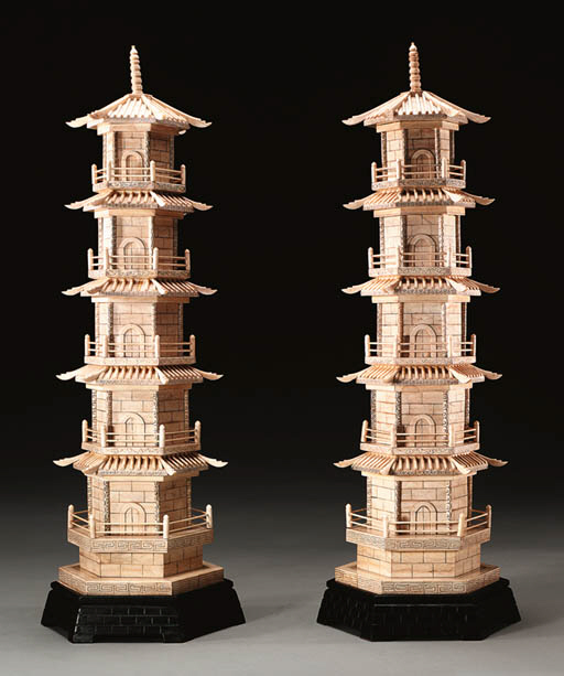 A PAIR OF IVORY PAGODAS**