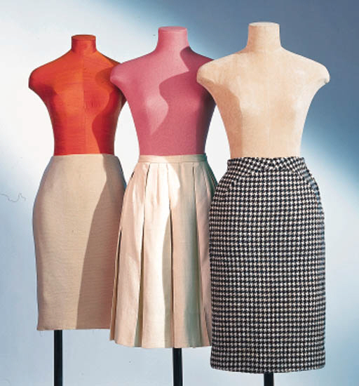 A GROUP OF SIX SKIRTS AND ONE