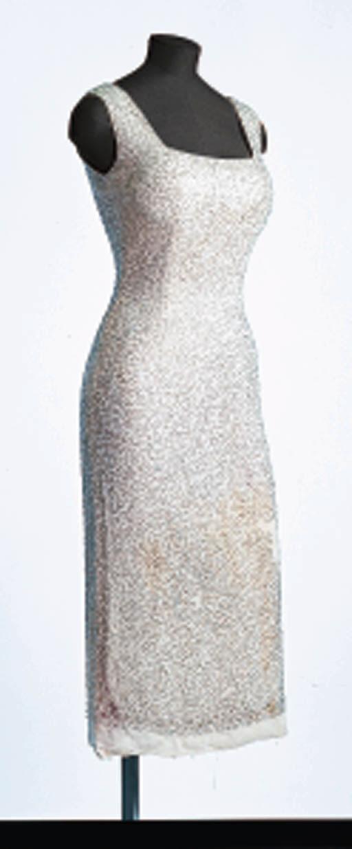 AN EVENING DRESS