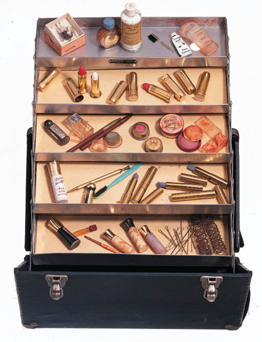A TRAVELING CASE AND MAKE-UP