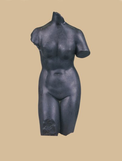 A CARVED GREY STONE FEMALE TOR