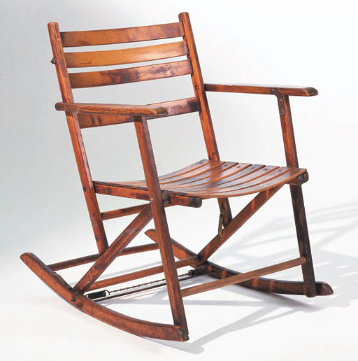 A STAINED WOOD FOLDING ROCKING