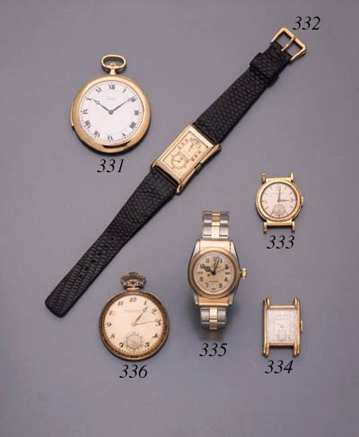Rolex. A 9K rectangular-shaped