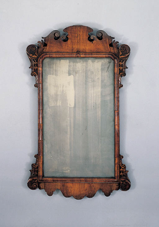 A GEORGE II WALNUT MIRROR