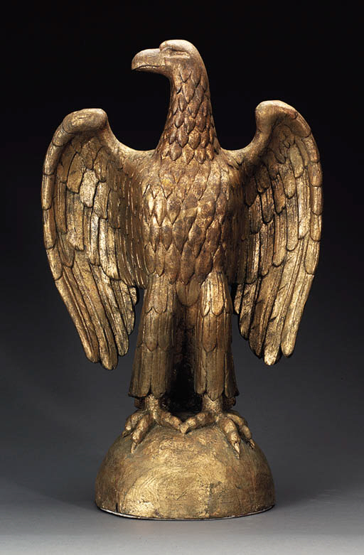 A CARVED AND GILTWOOD EAGLE
