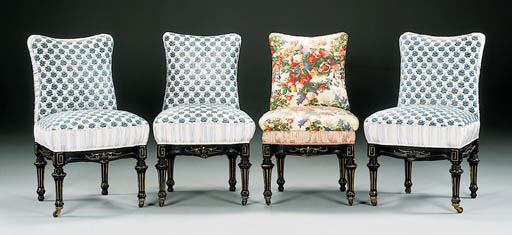 A SET OF FOUR RENAISSANCE REVIVAL EBONIZED AND GILT-DECORATED SIDE CHAIRS