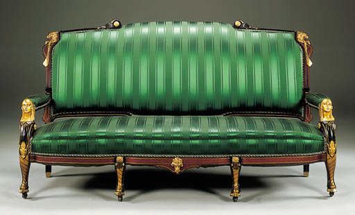 AN EGYPTIAN REVIVAL EBONIZED AND BRASS-MOUNTED SOFA
